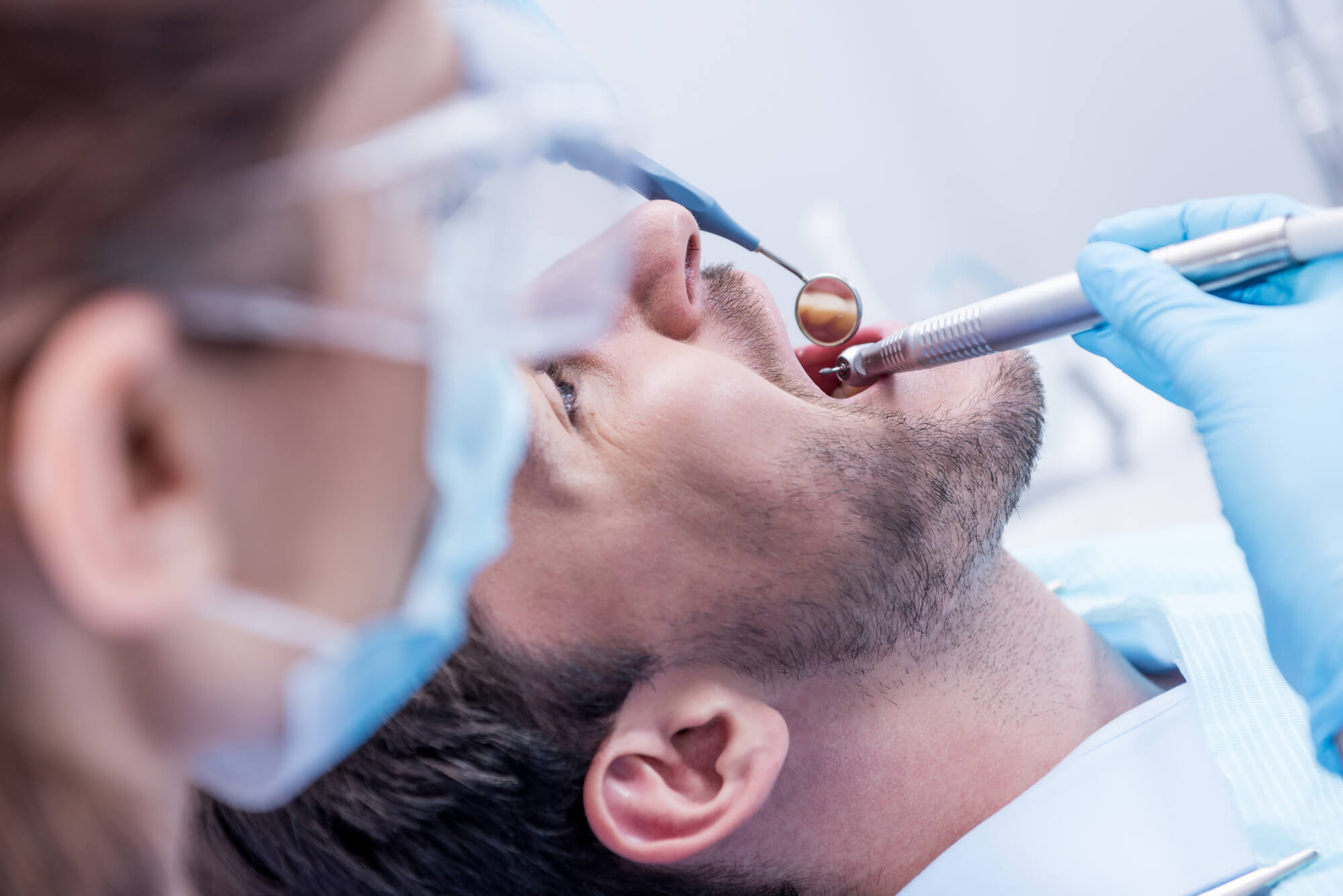 Periodontist Pembroke Pines examining patient's mouth
